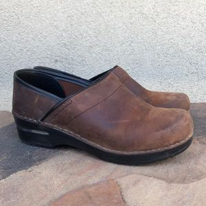 Sanita distressed leather clogs